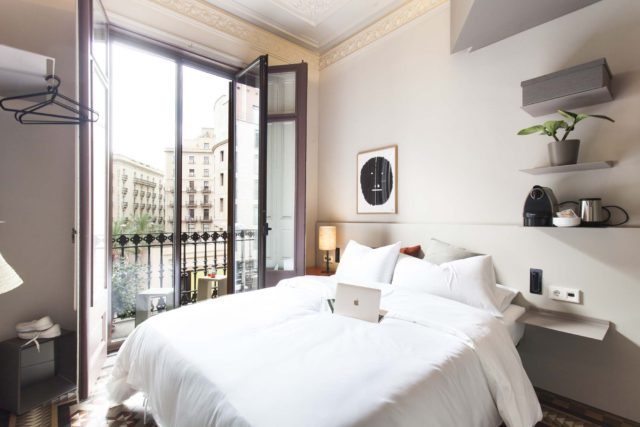 Alt text - DestinationBCN Room No1 interior and balcony in Barcelona